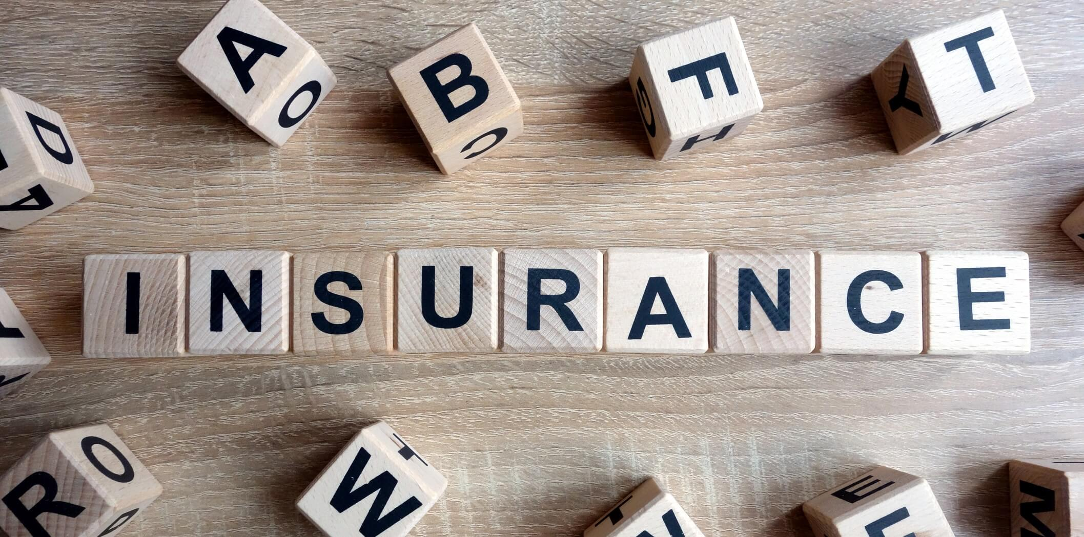 Insurance word from wooden blocks